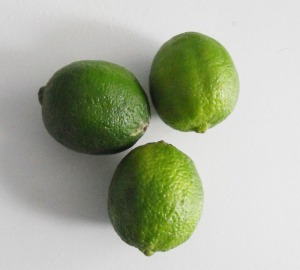 three limes on a table